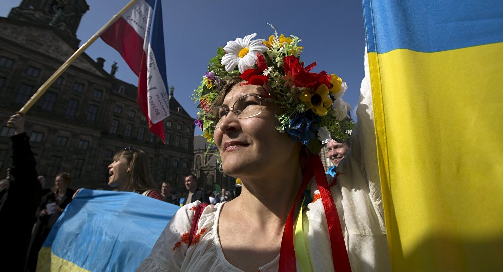 A Ukrainian woman stands in front of the Royal Palace during a demonstration on the EU referendum, at the Dam Square in Amsterdam, April 3, 2016