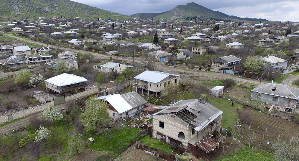 This aerial view shows destroyed houses during the fighting at Martakert province in the region of Nagorno-Karabakh, Azerbaijan, Monday, April 4, 2016