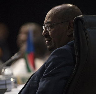 Sudanese President Omar al-Bashir attends the opening session of the AU summit in Johannesburg, Sunday, June 14, 2015