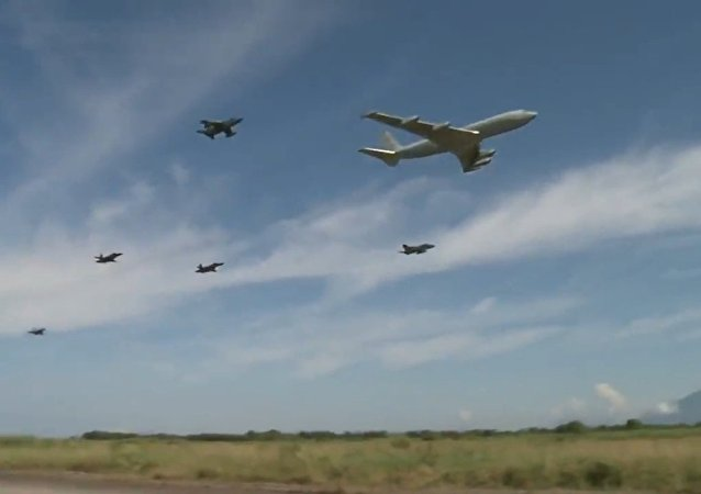 Brazilian air force jets escorting cargo plane, low fly