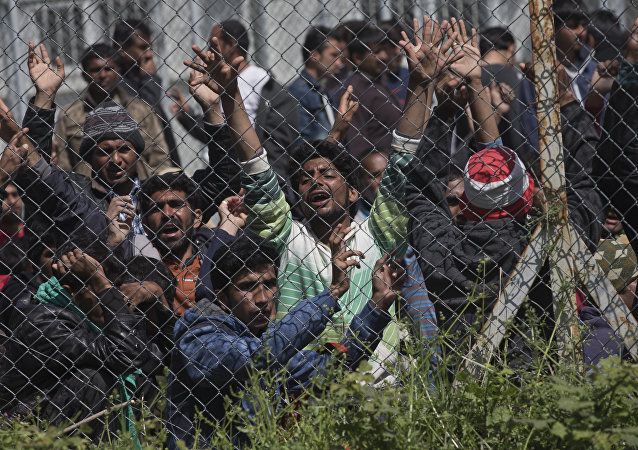 Migrants, most of them from Pakistan, protest against the EU- Turkey deal about migration inside the entrance of Moria camp in the Greek island of Lesbos on Tuesday, April 5, 2016