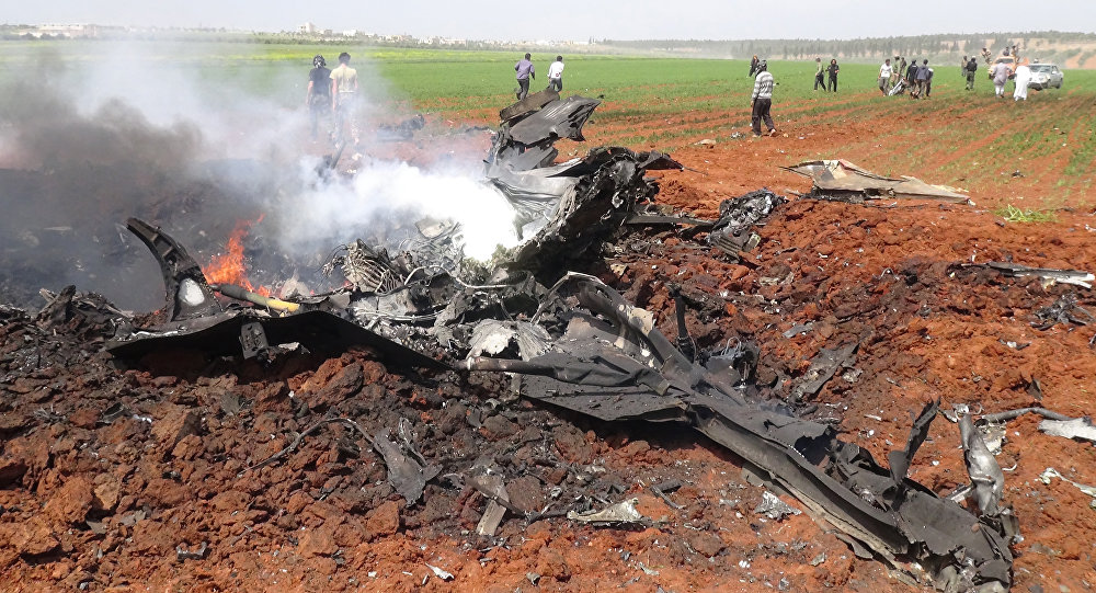 A general view shows the wreckage of a government warplane after Al-Nusra front (Al-Qaeda's Syria affiliate) reportedly shot it down over the northern Syrian town of Al-Eis on April 5, 2016