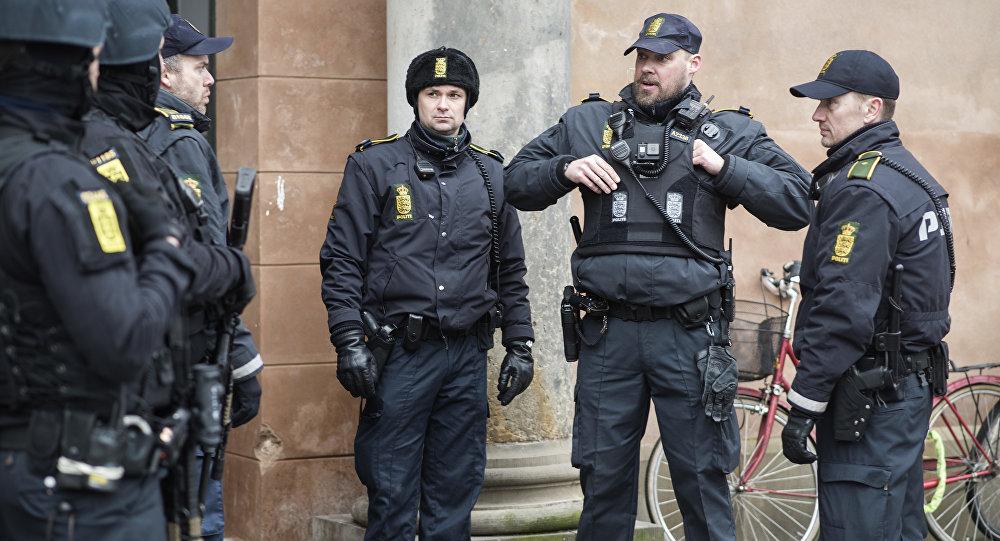 Danish policemen stand guard in front of the city court in Copenhagen, Denmark