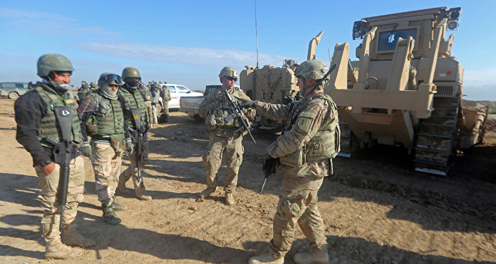 US soldiers give guidance as they train Iraq's 72nd Brigade in a live-fire exercise in Basmaya base, southeast of the Iraqi capital, Baghdad, on January 27, 2016