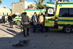 Emergency personnel and security forces stand next to ambulances  in the Egyptian town of El-Arish, in the Sinai peninsula (File)