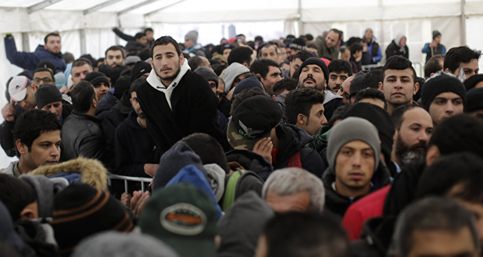Hundreds of migrants waits in a tent to continue their registration process at the central registration center for refugees and asylum seekers LaGeSo (Landesamt fuer Gesundheit und Soziales - State Office for Health and Social Affairs) in Berlin (File)