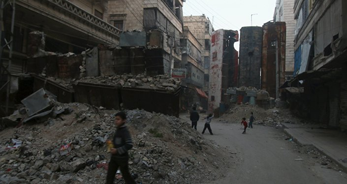 Children play near upright buses barricading a street, which serve as protection from snipers loyal to Syria's President Bashar al-Assad, in Aleppo's rebel-controlled Bustan al-Qasr neighbourhood, Syria April 6, 2016