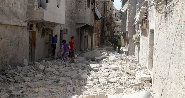 Residents inspect damages after an airstrike on the rebel held al-Maysar neighborhood in Aleppo, Syria, April 11, 2016.
