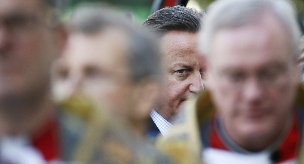 Britain's Prime Minister David Cameron arrives at the memorial service for victims of the attack on the Bardo Mudeum in Tunis and the Tunisian holiday resort of Port El Kantaoui in Sousse, at Westminster Abbey in central London, April 12, 2016.