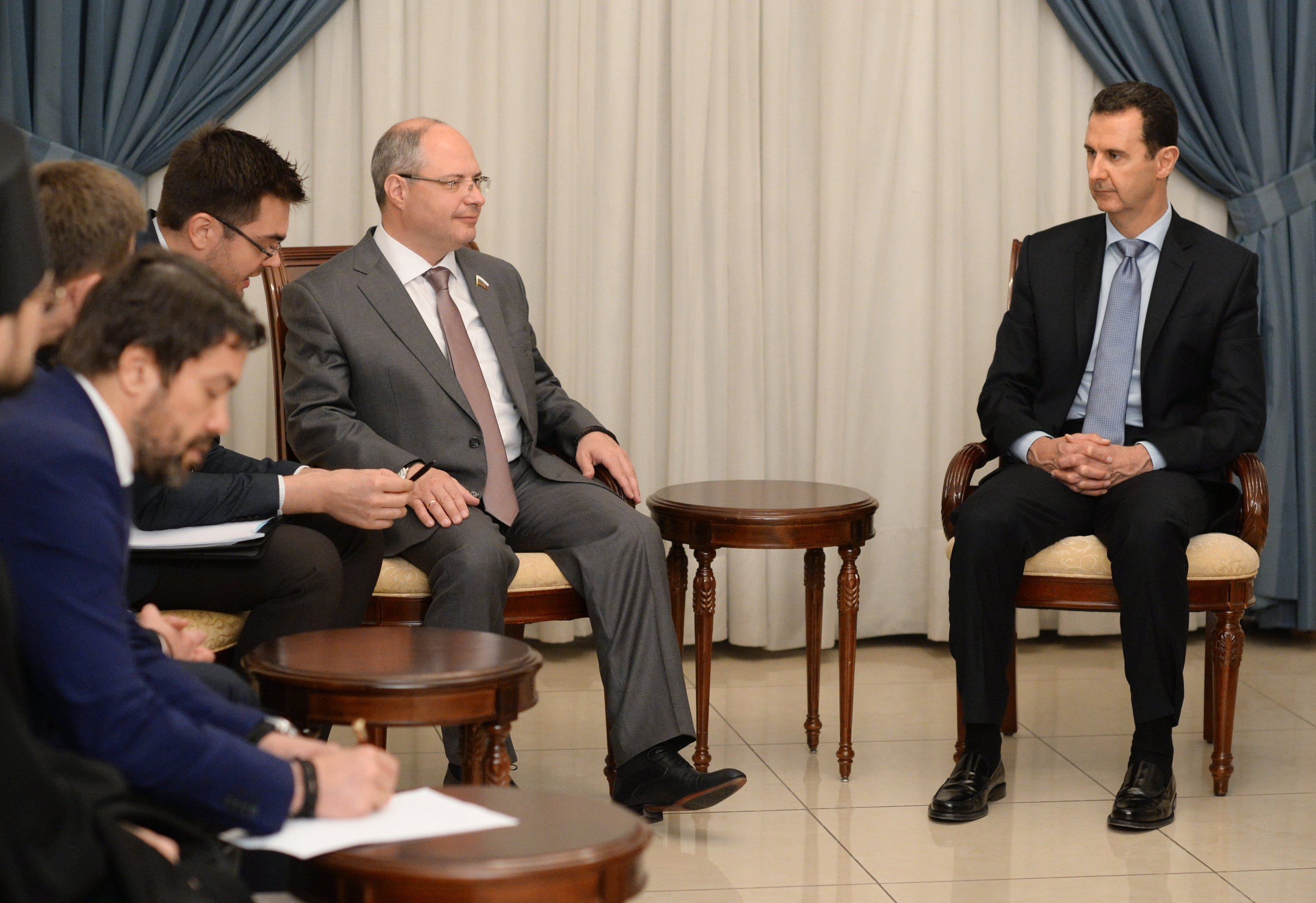 Syrian President Bashar al-Assad, right, meets with Russian parliamentary delegation in Damascus
