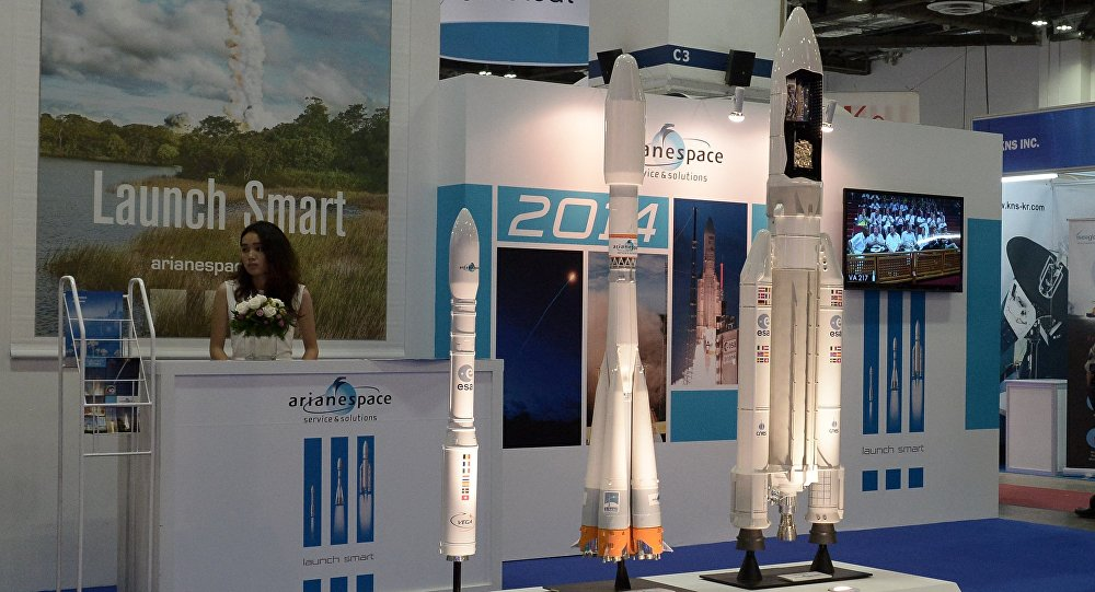 This photograph taken on June 16, 2014 shows the display booth of Arianespace, the European satellite launch company at the CommunicAsia and BroadcastAsia exhibition in Singapore