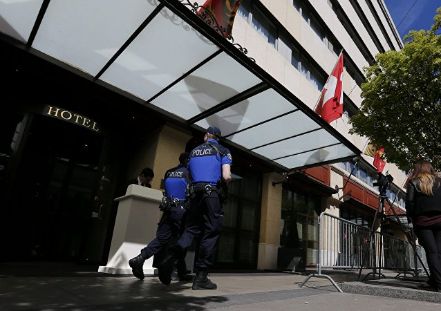 Geneva police patrol in front of the hotel where the High Negotiations Committee (HNC) stays ahead of the start of a new round of Syria Peace talks at the United Nations in Geneva, Switzerland, April 12, 2016