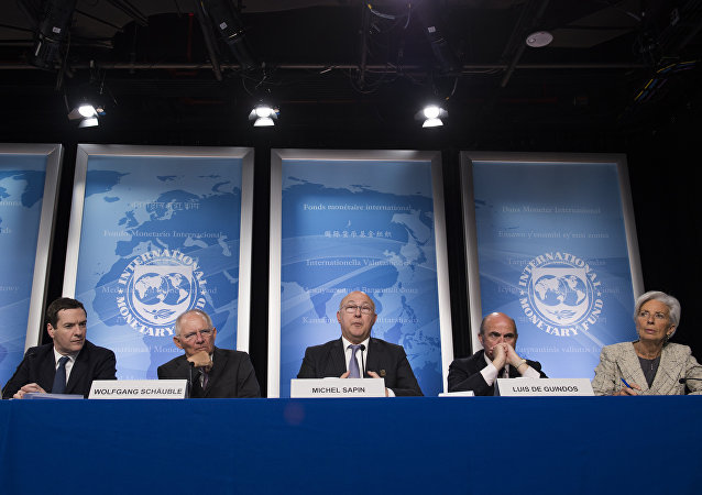 French Finance Minister Michel Sapin (C) speaks next to Chancellor of the Exchequer George Osborne (L), German Finance Minister Wolfgang Schauble (2nd L), Spanish Minister of Economy and Competitiveness Luis De Guindos (2nd R) and IMF Managing Director Christine Lagarde (R) during a press conference