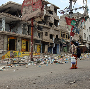 A picture taken on April 7, 2016, shows heavily damaged buildings on a street in Yemen's third city Taez as a result of clashes between Shiite Huthi rebels and fighters from the Popular Resistance Committees, loyal to Yemen's fugitive President Abedrabbo Mansour Hadi.