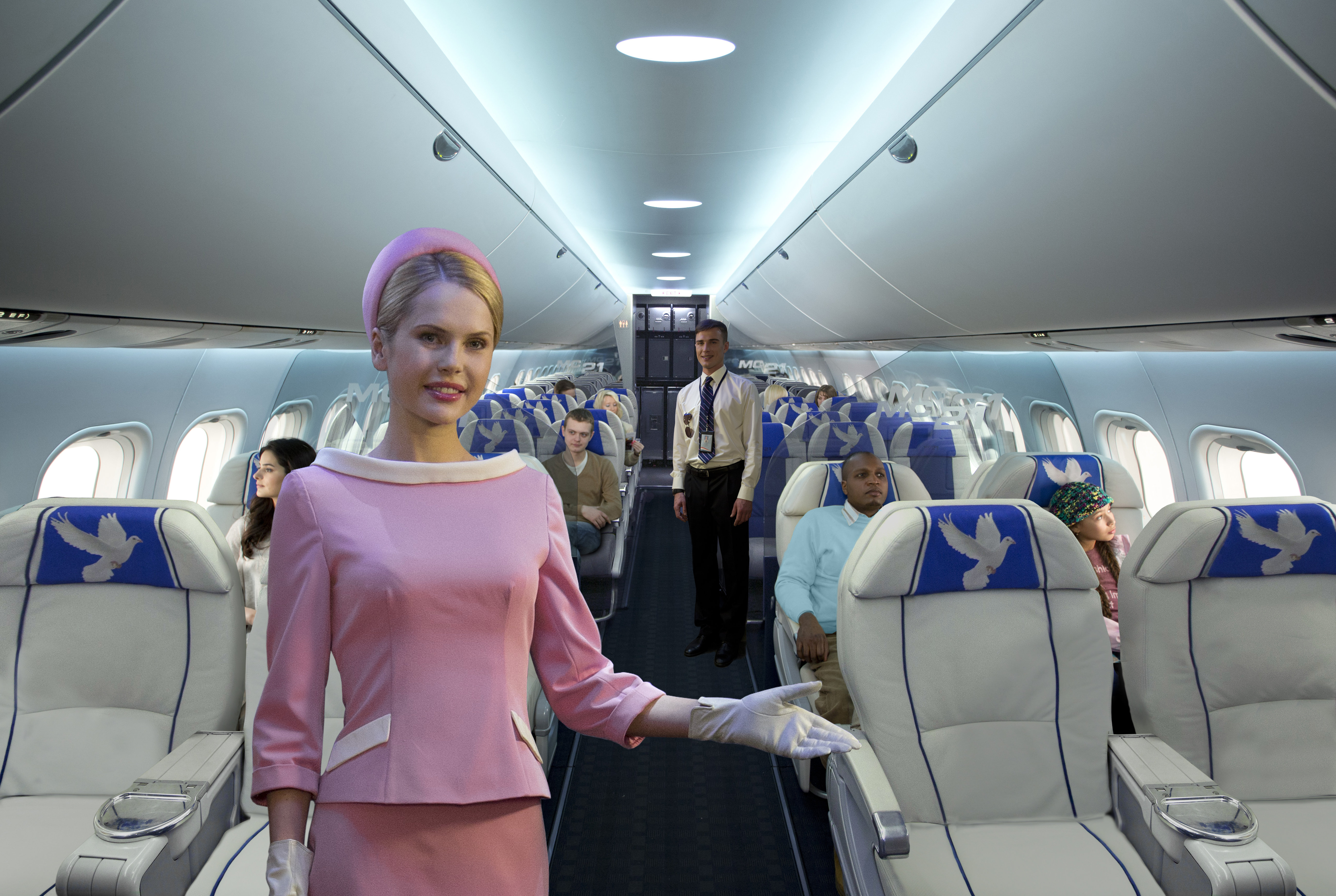 Passenger area of the MC-21, with a notably roomy aisle space.