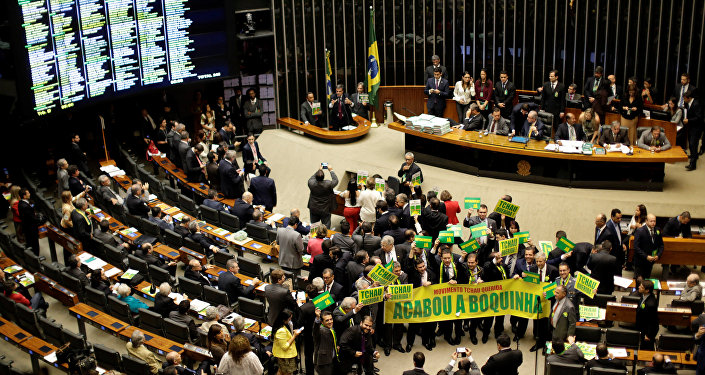 Lower house members who support the impeachment demonstrate during a session to review the request for Brazilian President Dilma Rousseff's impeachment, at the Chamber of Deputies in Brasilia, Brazil April 15, 2016