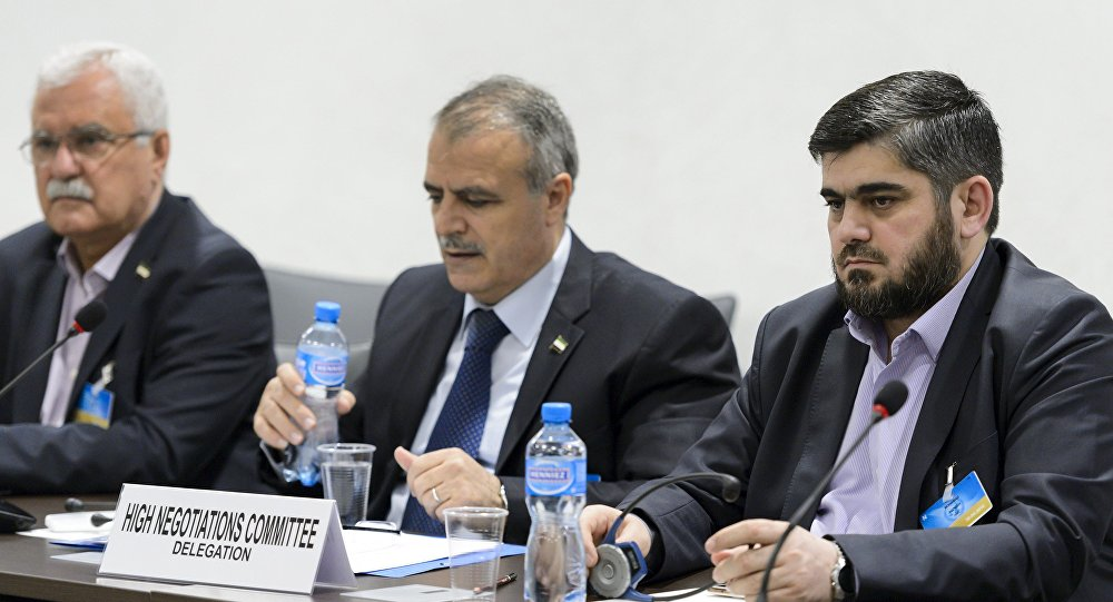 Members of the Syrian opposition delegation of the High Negotiations Committee (HNC) George Sabra (L) delegation head Asaad Al-Zoubi (C) and Chief negotiator, Army of Islam rebel group's Mohammed Alloush (R) attend a meeting with U.N. mediator on Syria Staffan de Mistura during Syria peace talks at the United Nations in Geneva, Switzerland, April 15, 2016
