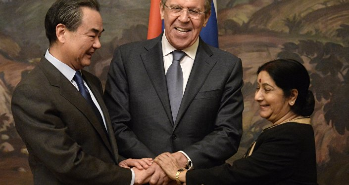 From left: Chinese Foreign Minister Wang Yi, Russian Foreign Minister Sergei Lavrov and Indian Foreign Minister Sushma Swaraj during are photographed before a plenary meeting of the foreign ministers of Russia, India and China (RIC).