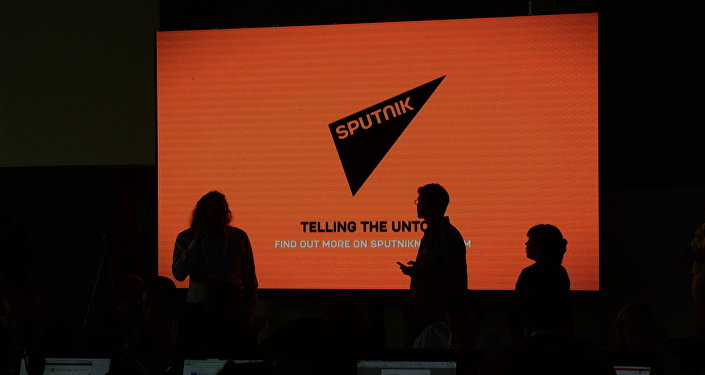 A screen with the logo of the Sputnik international news agency and radio