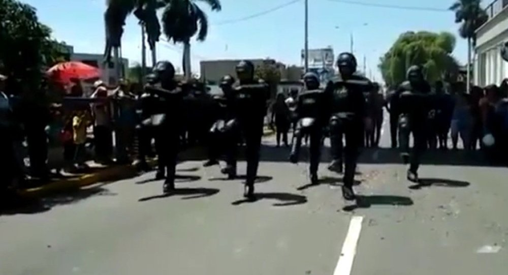 Impressive moment riot police break into DANCE in the street