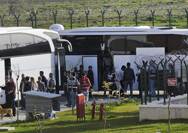 Turkish security members surround migrants after their arrival in Pehlivankoy, Kirklareli, Turkey. file photo