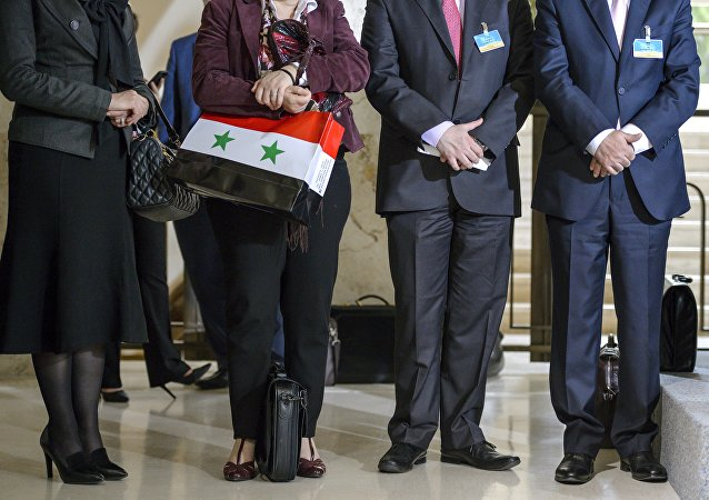 A member of the Syrian government delegation holds a bag picturing the Syrian national flag after a meeting with United Nations Syria envoy on Syrian Peace Talks on April 18, 2016 in Geneva