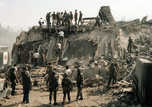 Rescue workers remove the body of a U.S. Marine from the rubble of the Marine Battalion headquarters at Beirut airport, Oct. 23, 1983