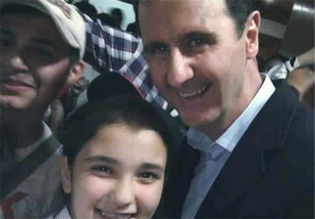 A kid takes a selfie with President Assad