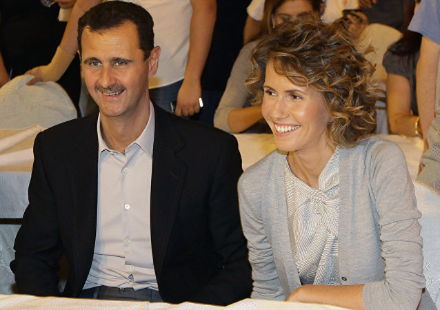 Syrian President Bashar Assad and his wife Asma. file photo