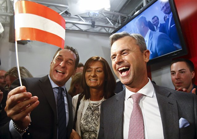 Presidential candidate Norbert Hofer (R) and head of the Austrian Freedom party Heinz-Christian Strache (L) react at the party headquarter in Vienna, Austria, April 24, 2016.