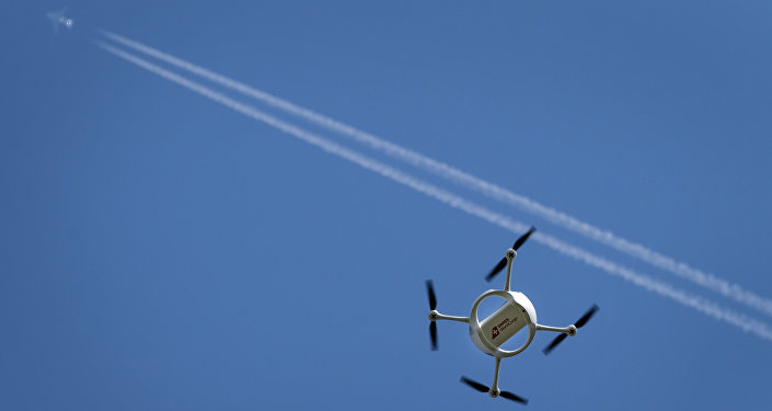 A drone carrying a mail box of Swiss Post flies past on July 7, 2015 above the airport of Bellechasse, western Switzerland