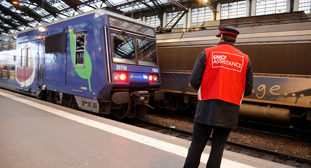 A staff member of French state-owned railway company SNCF stands on a platform inside the Gare de Lyon railway station in Paris, France, April 26, 2016 during a one-day strike by French railway unions workers to protest working conditions and wages.