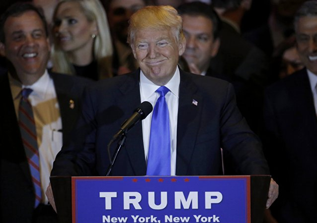 Republican US presidential candidate Donald Trump speaks, as New Jersey Governor Chris Christie (L) looks on, during Trump's five state primary night event in New York City, US, April 26, 2016