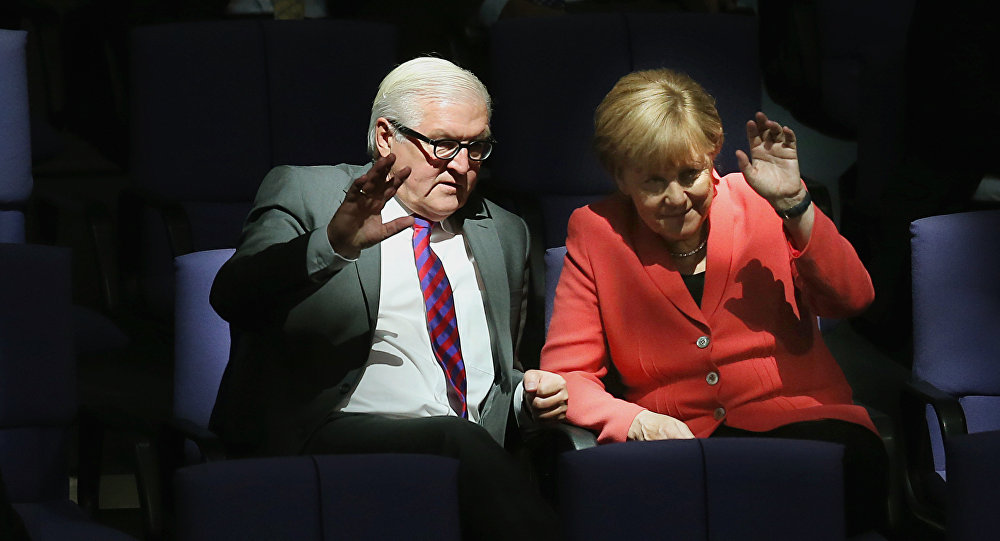 German Chancellor Angela Merkel, right, and Foreign Minister Frank-Walter Steinmeier wave as they attend a meeting of the German Federal Parliament, Bundestag, at the Reichstag building in Berlin, Germany, Thursday, Sept. 24, 2015