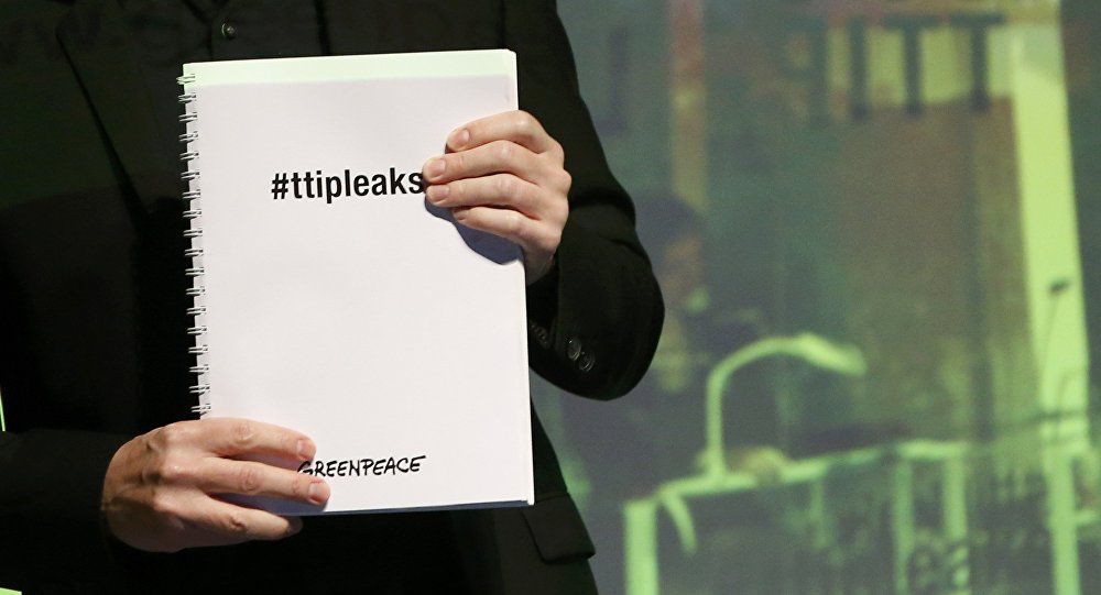 Volker Gassner of the environmental campaign group Greenpeace holds a copy of the leaked TTIP negotiations during a news conference in Berlin, Germany, May 2, 2016