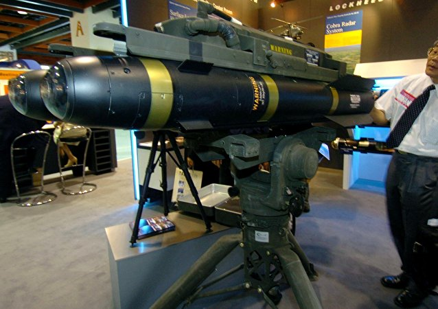 A man looks at the latest US-made Hellfire II missiles during at the defense industry exhibition in Taipei, 11 August 2005