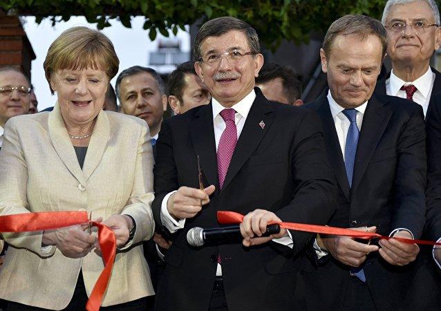 German Chancellor Angela Merkel, Turkish Prime Minister Ahmet Davutoglu and EU Council President Donald Tusk
