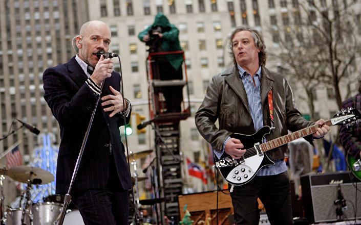 Michael Stipe, left, Peter Buck, right, and R.E.M. perform on NBC's Today in New York's Rockefeller Plaza.