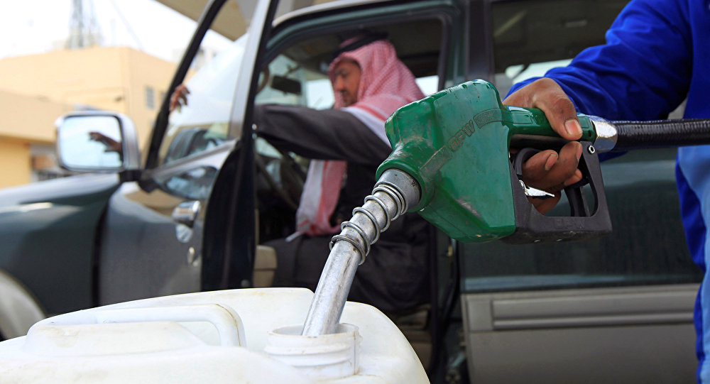 An employee fills a container with diesel at a gas station in Riyadh.