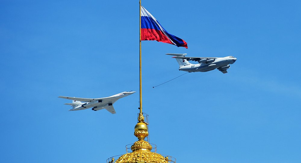 The Tu-160 bomber is seen flying during the Victory Day Parade in Moscow on May 9, 2016