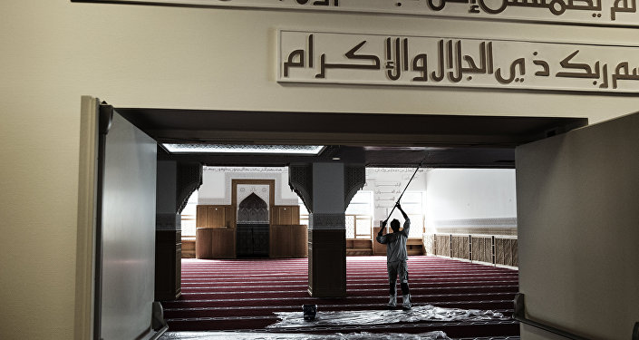 A worker paints a wall inside the mosque in Rovsingsgade in Copenhagen on June 16, 2014