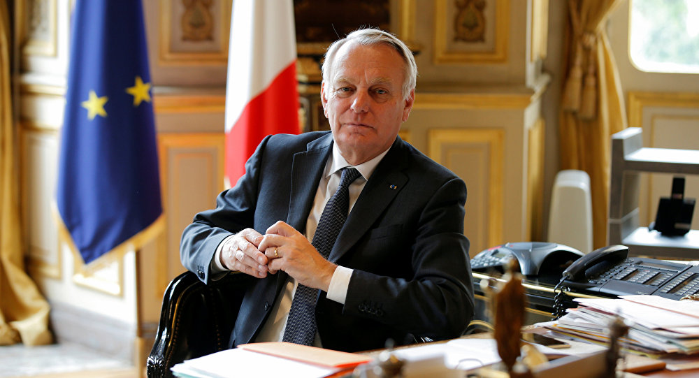 French Foreign Affairs Minister Jean-Marc Ayrault poses in his office at the Quai d'Orsay ministry in Paris, France, April 26, 2016