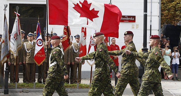A military unit from Canada marches during a military parade marking Polish Armed Forces Day, in Warsaw, Poland (File)