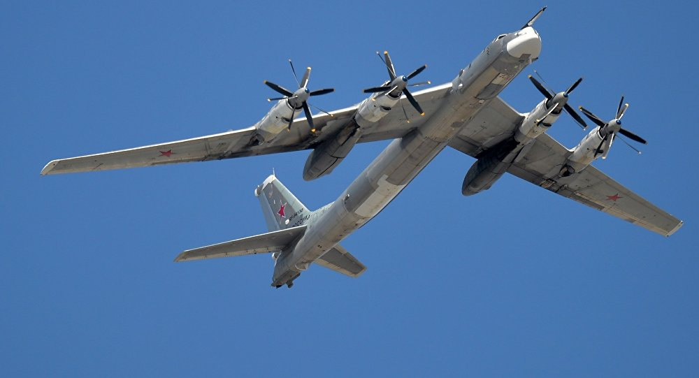 The Tu-95MS is seen flying during the rehearsal of the May 9 Victory Day Parade in Moscow