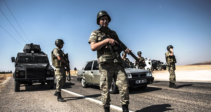 Turkish soldiers stand near the Turkey-Syrian border post in Sanliurfa, on September 4, 2015