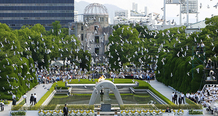 Doves fly over the Peace Memorial Park with a view of the gutted A-bomb dome at a ceremony in Hiroshima, Japan August 6, 2010