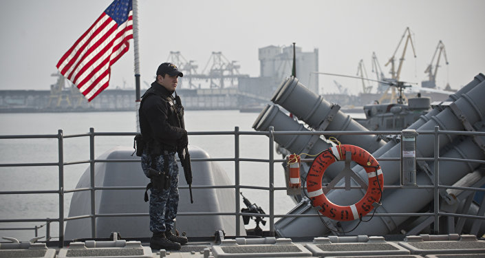 A US soldier stands guard at the USS Vicksburg cruiser ship docked at Constanta harbour in Constanta, Romania, on March 13, 2015.