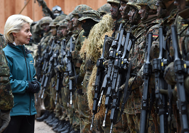 German Minister of Defense Ursula von der Leyen (C) posing with mountain infantry soldiers of the mountain infantry brigade 23 after she watched an exercise near the Bavarian village Bad Reichenhall, southern Germany, on March 23, 2016