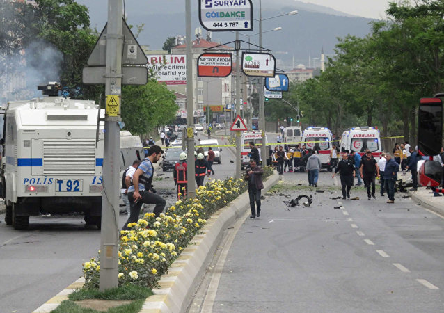 Security officers gather at a scene following a vehicle explosion near a military facility in Istanbul, Turkey, May 12, 2016.