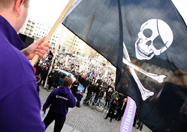 Supporters of the web site 'The Pirate Bay', one of the world's top illegal filesharing websites, demonstrate in Stockholm (file)